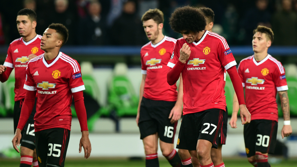 (L-R) Manchester United's English midfielder Jesse Lingard (35), Manchester United's Belgian midfielder Marouane Fellaini (27) react after the UEFA Champions League Group B second-leg football match VfL Wolfsburg vs Manchester United in Wolfsburg, central Germany, on December 8, 2015. Manchester United crashed out of the Champions League on Tuesday with a 3-2 defeat at Wolfsburg, who made club history by reaching the knock-out stages. AFP PHOTO / JOHN MACDOUGALL / AFP / JOHN MACDOUGALL (Photo credit should read JOHN MACDOUGALL/AFP/Getty Images)