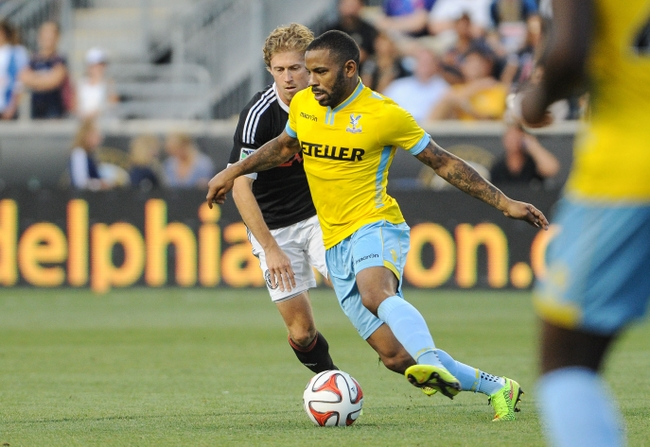 Jul 25, 2014; Chester, PA, USA; Crystal Palace midfielder Jason Puncheon (13) moves the ball as Crystal Palace midfielder Yannick Bolasie (7) defends during the second half of the match at PPL Park. Crystal Palace FC won the match 1-0. Mandatory Credit: John Geliebter-USA TODAY Sports