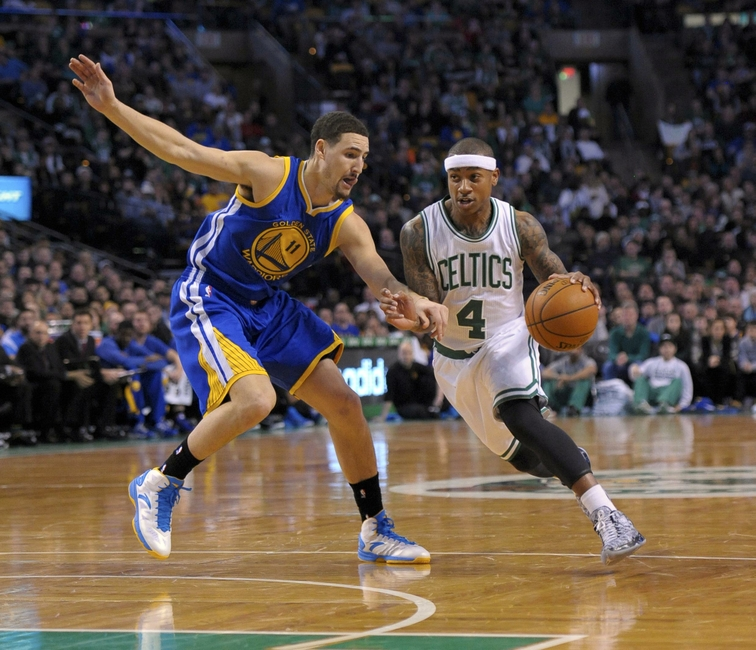 Mar 1, 2015; Boston, MA, USA; Boston Celtics guard Isaiah Thomas (4) controls the ball while being defended by Golden State Warriors guard Klay Thompson (11) during the first half at TD Garden. Mandatory Credit: Bob DeChiara-USA TODAY Sports